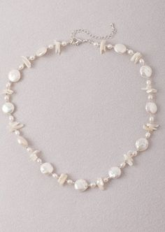 White Pearl and Ivory Mother of Pearl Necklace. http://store.nightlightinternational.com/product_p/p005bn.htm $44.99. For Freedom's Sake.