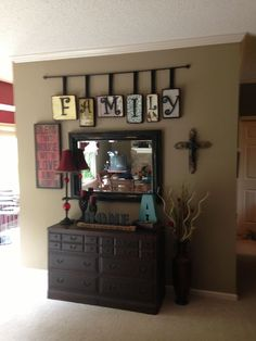 Pinning this for the curtain rod & wooden letters! Above clock over mantle?