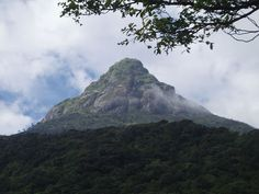 """Adam's Peak (also Sri Pada; Sinhalese Samanalakanda -""""butterfly mountain"""",""""Sri Paadaya""""; Tamil Sivanolipatha Malai - சிவனொளி பாதமலை), is a 2,243 m (7,359 ft) tall conical mountain located in central Sri Lanka. It is well known for the Sri Pada, i.e., """"sacred footprint"""", a 1.8 m (5 ft 11 in) rock formation near the summit, which in Buddhist tradition is held to be the footprint of the Buddha,"""