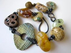 Taller Than Trees - primitive assemblage golden green shimmer raku, art beads, Roman glass, stone and amber nuggets, & copper charm bracelet by LoveRoot, $68.00