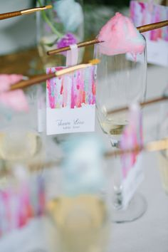 Watercolor escort cards. Cotton candy champagne glasses. Art gallery wedding. Place cards by @takenoteinvites Photo by Clifton Photography. Stephanie Rose Events