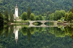 Bohinj or Bohinj Basin (Slovene: Bohinjska kotlina) is a 20 km long and 5 km wide basin within the Julian Alps, in the Upper Carniola region of northwestern Slovenia. It is traversed by the Sava Bohinjka river. Its main feature is the periglacial Lake Bohinj (Slovene: Bohinjsko jezero). Bohinj is part of the eponymous municipality, the centre of which is located at Bohinjska Bistrica.