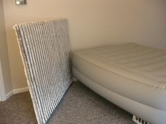 Easy DIY headboard for staging or even a nice or cute gesture for guests using air mattresses!