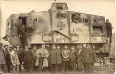 Captured German A7V tank on a flatbed train car. - WWI
