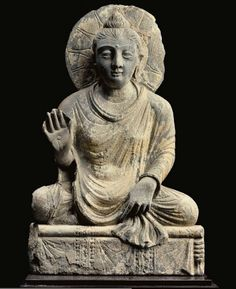 A gray schist figure of the seated Buddha  - GANDHARA, 2ND/3RD CENTURY | Christie's