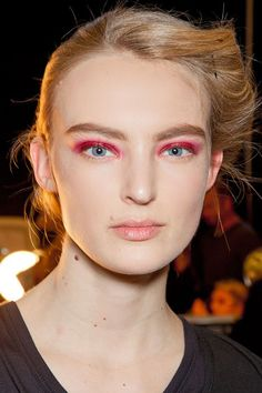 Donna Karan - Defined Brows fall 2012 - not crazy about the brows but love the red eyes.