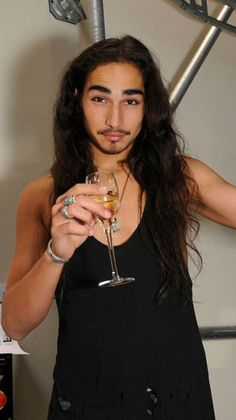 Willy Cartier pops open some cheap ass BubbZ to getthe party started.