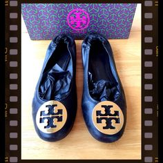 """LISTING TORY BURCH """"REVA"""" ballet flats Tory Burch """"REVA"""" flat, black leather, round toe with gold logo. WELL USED, NO HOLES.  PLEASE OBSERVE PHOTOS WELL.  I TOOK THE PICTURES IN HI-DEFINITION SO YOU CAN BETTER SEE.  CAN EASLY BE CARED FOR BY A SHOE REPAIR MAN.  I POLISHED AND BUFFED THEM UP THE BEST THAT I CAN. For an all over look of them it's not extremely noticeable. (Note first and last photo) NO LOWBALLING OR WILL BE BLOCKED.  BOX IN PHOTO IS NOT INCLUDED, plus it's not the box""""for""""…"""