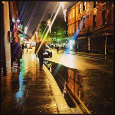 Manchester lights glistening in the rain.