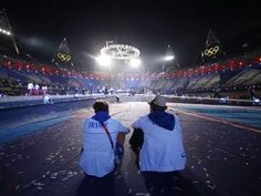 French athletes Amelie Cazae & Julien Bahain sit after the Closing Ceremony, August 13, 2012.