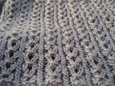 A simple cowl with a mock cable lace that uses one skein of Debbie Bliss Pure Silk.