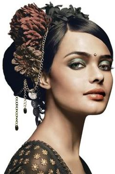 A Contemporary Indian Bridal Up do Hairstyle with Flowers