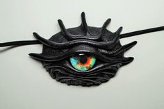 Dragon eye eye patch black leather. Snake eye patch. Blue eye