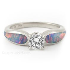 Red Opal and Diamond Engagement Ring. would love this as an engagement ring!!!!<3