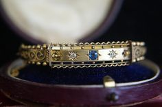 A late Victorian Etruscan bangle. 15ct gold with diamonds and a sapphire. Just added to CJAntiquesLtd.com #antiquejewelry #victorian #gold #sapphire #diamond #bangle #bracelet