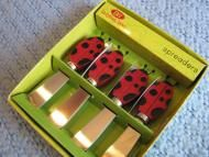 Price $12.00 - Set of 4 Whimsical Cocktail Stainless Spreader Knives - Ladybugs Doing some Summertime Entertaining Thisis a set of 4 spreading knives, imported by Boston Warehouse.What makes them so special is thatthe handlesare shaped like adorable red Ladybugs - complete with their black spots and little antenna...