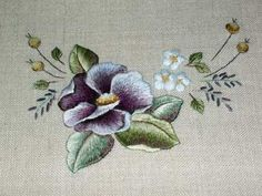 A Violet by Trish Burr in South Africa  - needle painting, long and short stitch shading - closeups on site