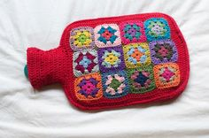Beautiful granny square hot water bottle cover via Foxs Lane