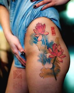 Pink lotus flower tattoos with long stems. The two lotus flowers are shown to be in different states as one is fully bloomed and the other one is half bloomed. Surrounding them are their leaves and waves of water.