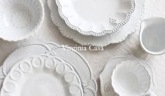 love this all white scrolled detailed table setting