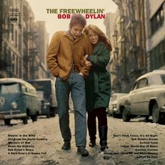 Freewheelin' was Bob Dylan's second album. It was released in 1963. The photograph was taken on West 4th street and the corner of Jones in Greenwich Village, New York, where the couple had an apartment down the block. The photograph was taken by a CBS staff photographer, Don Hunstein.