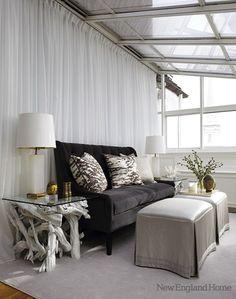 Suzie: New England Home - Modern sunroom design with white sheers, black velvet tufted sofa, ...