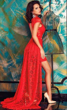 Dark-haired, shapely Romanian beauty Claudia Stoica in a  sexy red lace dress.
