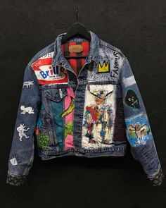 "We call this jacket "" The MoMa "" Louis Vuitton cut and sew on the cuffs and details on the elbow. Hand Painted Warhol details , with Haring down the sleeve. Hand painted Basquiat artwork on the left. Painted Denim Jacket, Painted Jeans, Denim Jacket Men, Painted Clothes, Hand Painted, Denim Patch Jacket, Custom Denim Jackets, Mode Punk, Battle Jacket"