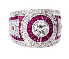 A ruby ring  18 kt. white gold, with rubys, total c. 2.50 ct. and 103 round brilliant-cut diamonds