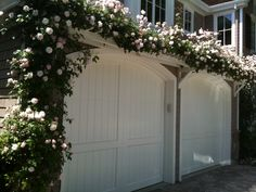 Love the idea of a plant covered arbor over the garage
