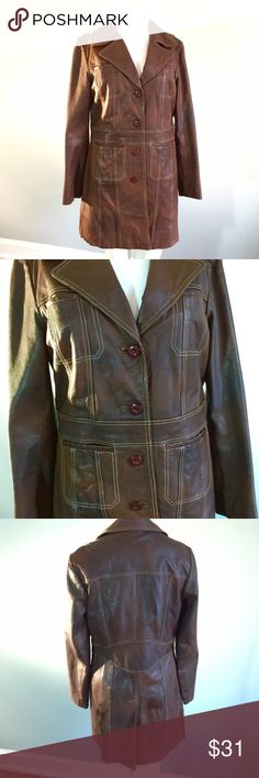 """Distressed Vintage Brown Leather Coat The coat's construction is in great shape, but the leather itself shows some discoloration and uneven color due to it's age. Last photo shows closeup of the discoloration (perhaps due to water exposure?). I think it makes it look cool and authentic. Bust 40"""", waist 34"""", length 33"""", sleeve length 24"""". Lined. Wilsons Leather Jackets & Coats"""