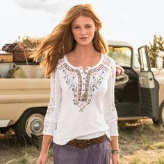 "GRACE HENLEY -- Sheer lace inset accents grace our embroidered henley shirt with metal buttons. Cotton. Machine wash. Imported. Exclusive. Sizes XS (2), S (4 to 6), M (8 to 10), L (12 to 14), XL (16). Front approx. 25""L."