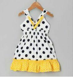 Vestido pepas amarillo y negro