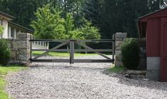 barn built in fence with barn door Entrance Gates, Farm Entrance, House Entrance, Driveway Gate, Fence Gate, Farm Gardens, Outdoor Gardens, Gates And Railings, Outdoor And Country