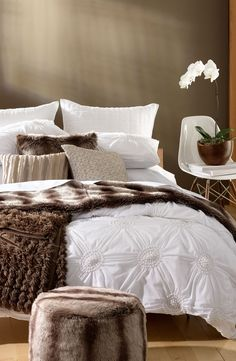 Dreamy duvet with puckered florets perfect for snuggling in.