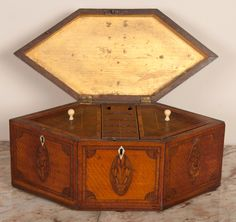 Interior of George III Period Hexagonal Satinwood and Marquetry Inlaid Tea Caddy having oval Prince of Wales feather decoration and multiple lines of string inlay and crossbanding. 1stdibs/Rumi