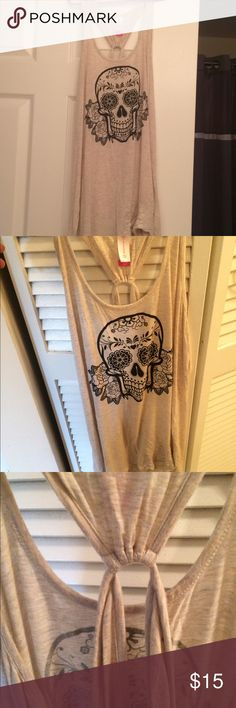 Awesome SKULL tank w/back accents Awesome SKULL tank w/back accents creamy white & black - can knot tie on bottom or wear straight ... pretty Kewl! It's 2x but I like these like that for cool tanks & bra's under ;) xo HAPPY POSHING! NB Tops Tank Tops
