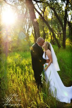 I love shots like this, with the sun shinning in the background like a glory ray and trees!!!