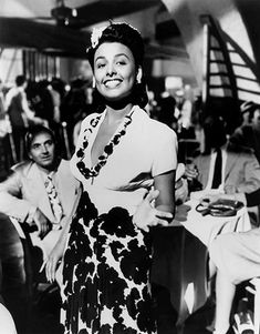 Lena Horne In Paris Singer Lena Horne singing into mike on stage as they bandleader conducts an orchestra behind her in nightclub. Description from pinterest.com. I searched for this on bing.com/images