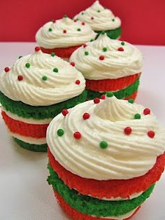 Christmas Cupcakes: Slice red & green cupcakes & alternate the layers.  Fill with marshmallow buttercream (or whatever frosting you like) between the layers & swirled on top.  Sprinkle with red & green large non-pareils.