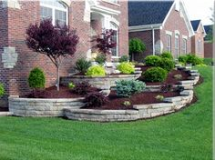 A lovely brick home with nicely used retaining walls for the landscaping going along the side of the home leading all the way up to the front door. Very nicely balanced and done.