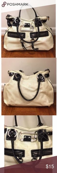 """Guess bag ❤ So roomy and cute! Original patent leather color was off white, but has aged to a yellowish tint. Color still looks very nice to me though, kind of like a cream color. Color is even throughout except for underneath the """"G"""" logo (pictured). Handles and hardware are in pretty good shape with minimal fraying and some scratches on hardware, but nothing notable. Inside has a zipper and cellphone compartment, clean with the exception of a few pen marks. Medium size. Guess Bags Shoulder…"""