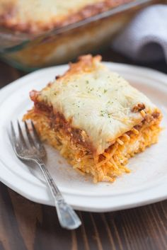 Million Dollar Spaghetti is a DELICIOUS easy dinner idea! Noodles are layered with a cheesy center and topped with a homemade meat sauce and cheese.