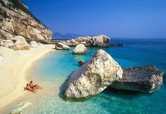 Sardinia is the second-largest island in the Mediterranean, after Sicily. Though large and populated with 1.6 million people, Sardinia appeals mainly to nature lovers who can explore its three national parks, splash around in aquamarine waters and inhale the heady scents of mimosa and oleander