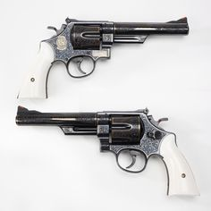 """Smith & Wesson Model 57 - June of 1964 marked the introduction of both the .41 Magnum cartridge and the Smith & Wesson Model 57 revolver.  It would be hard to find a nicer engraved example of the """"N"""" frame M57 revolver than this example, fitted with elephant ivory grip panels.  The tasteful gold accents don't hurt, either. At the NRA National Firearms Museumin Fairfax, VA"""