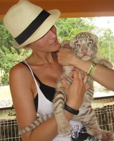 Playing with baby white tigers at a Zoo in Puerta Vallarta, Mexico