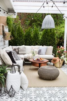 A modern eclectic farmhouse covered patio outdoor space. Perfect for the warmer months, cozy with textures and lots of patterns. Stenciled patio.