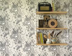 String pocket shelf with St. Jude's wallpaper pattern by Angie Lewin