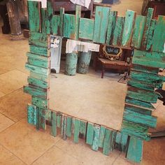 Mirror using scrap wood pieces for the frame