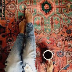 Beautiful rug, comfy jeans and a cup of coffee. Perfect Sunday.